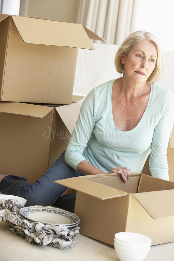 Senior Woman Moving Home And Packing Boxes stock image