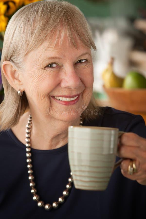 Download Senior woman with mug stock photo. Image of gray, drink - 16708992