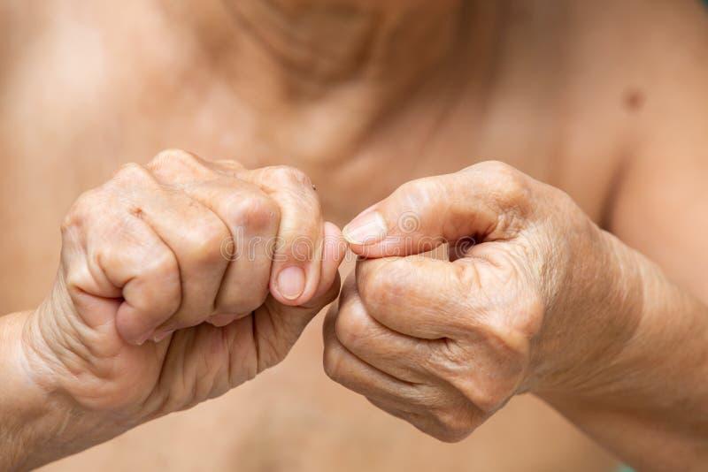 Senior woman nibbling nails, Body language feeling royalty free stock photos