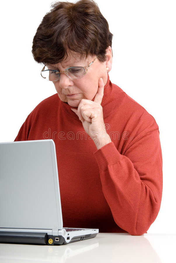 Senior woman with a notebook. Senior woman in front of a computer. Studio picture. Full isolated stock photos