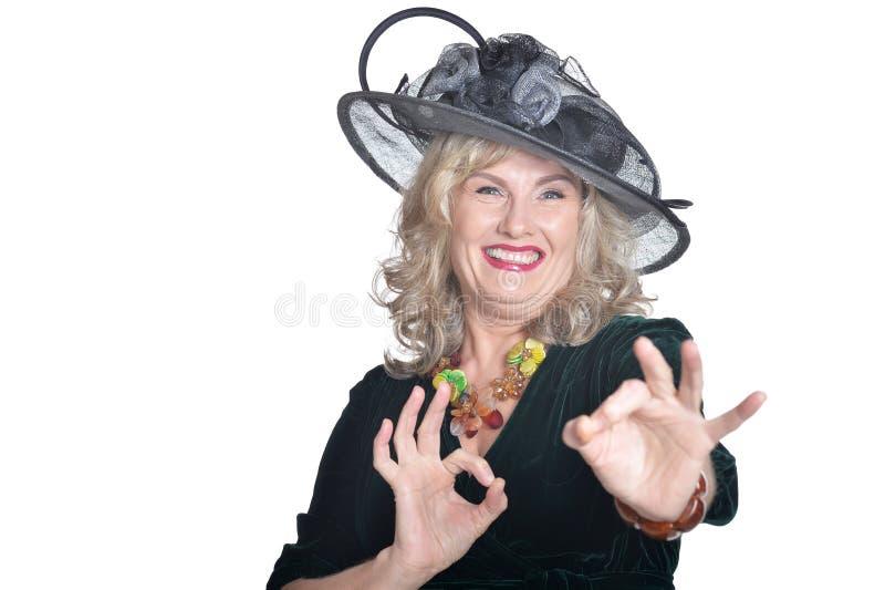 Senior woman with ok gestures on white background royalty free stock photos