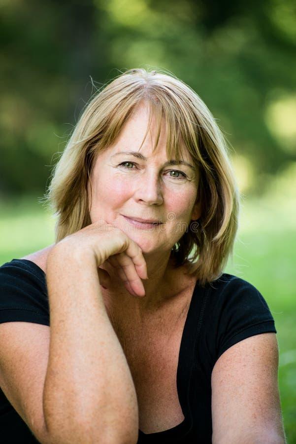 Senior woman outdoor portrait stock images