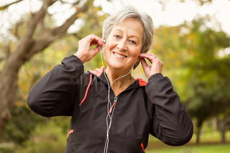 Senior woman in the park royalty free stock photo