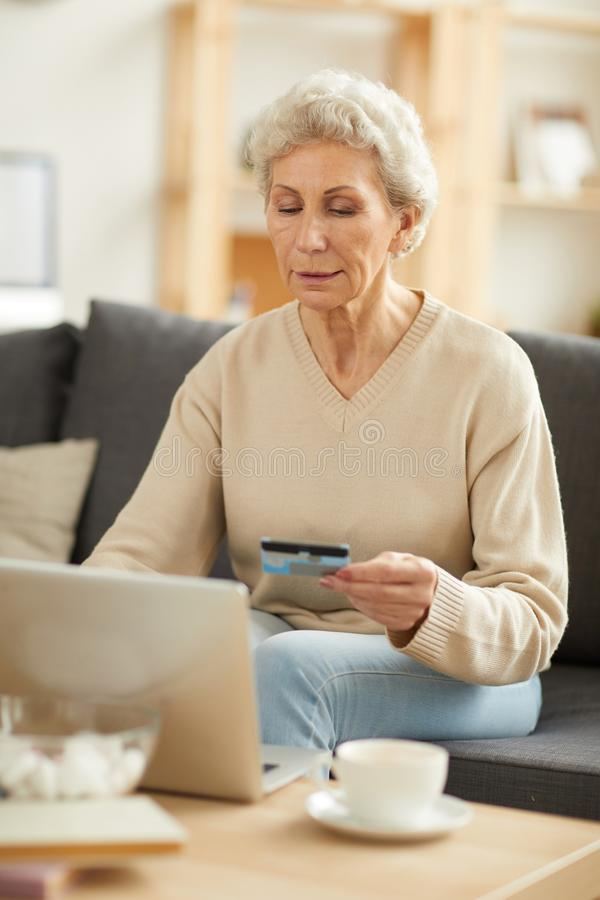 Senior Woman Paying Taxes stock image