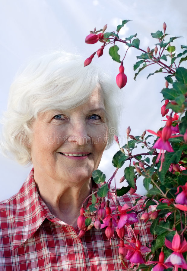 Senior woman and plant stock image