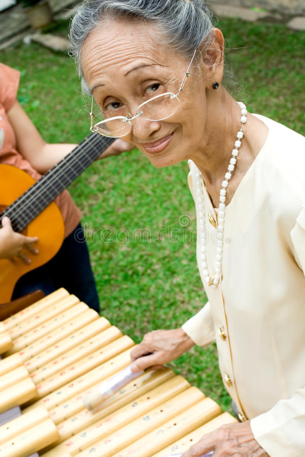 Senior woman play music royalty free stock photography