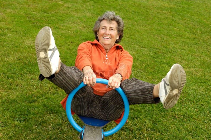 Senior woman on playground stock photo
