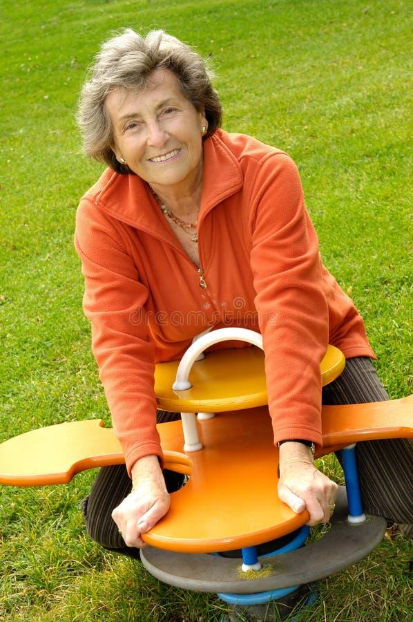 Senior woman at playground royalty free stock photos