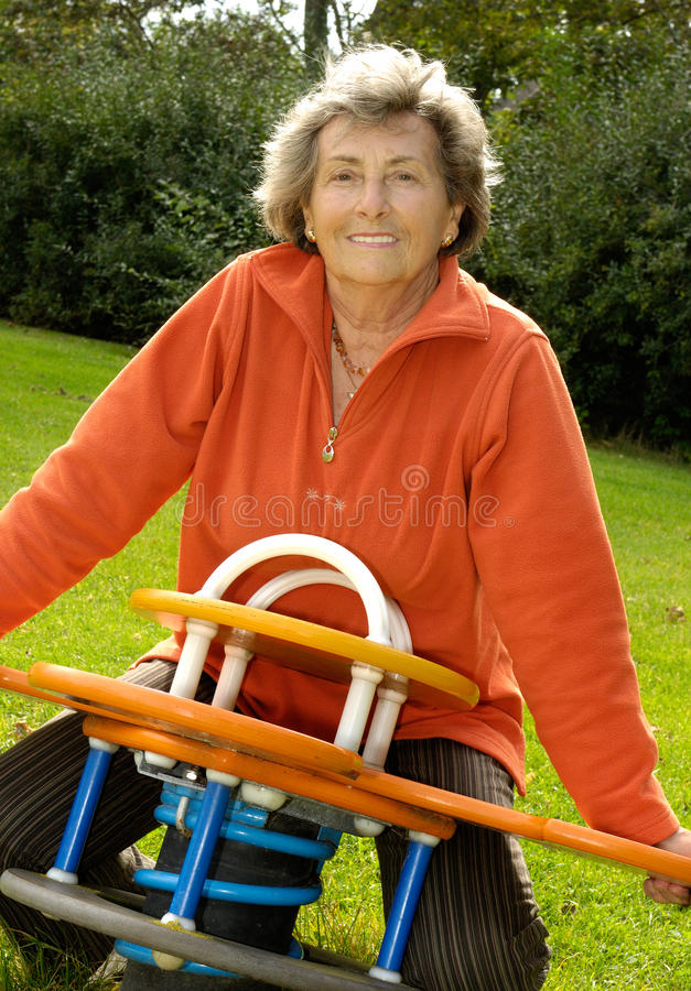 Senior woman at playground royalty free stock photo