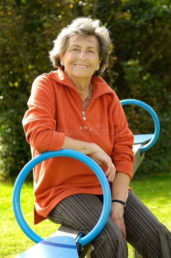 Senior woman at playground stock photos