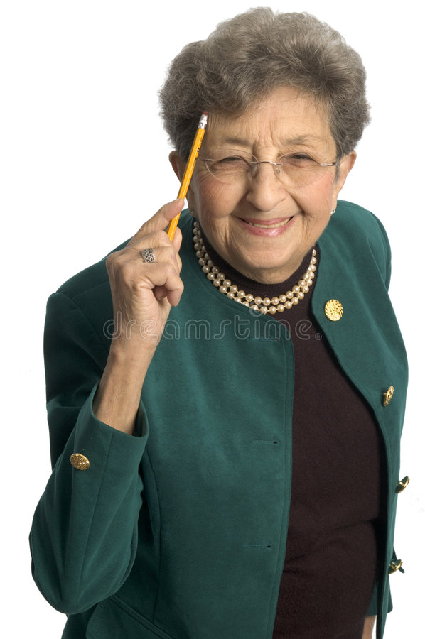 Senior woman pointing to head stock photos