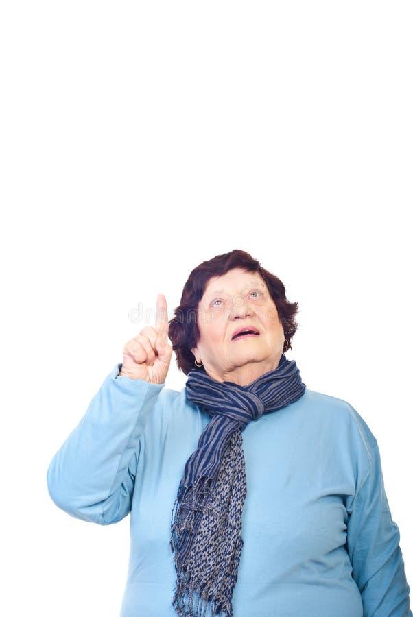 Senior woman pointing up stock image