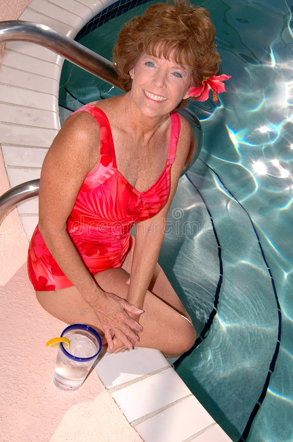 Senior woman by the pool royalty free stock photos