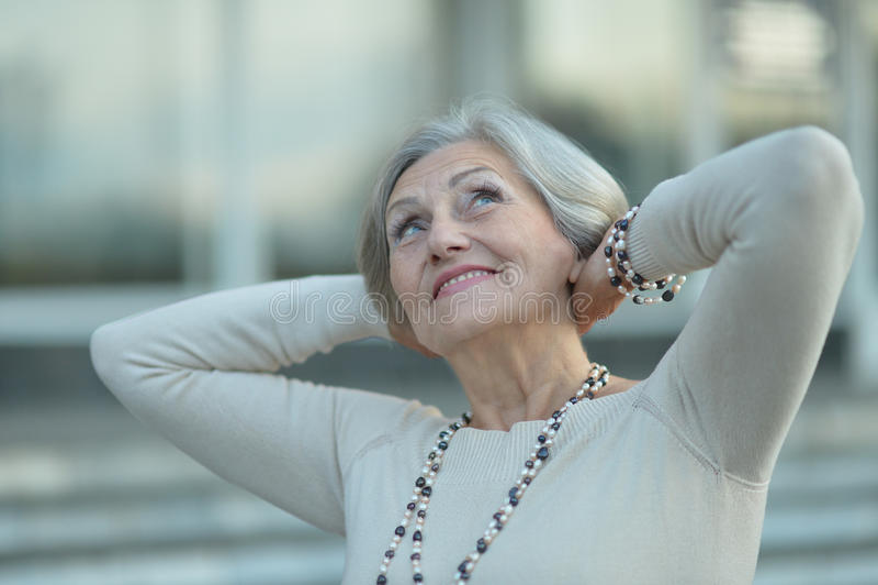 Senior woman portrait outdoor stock photo