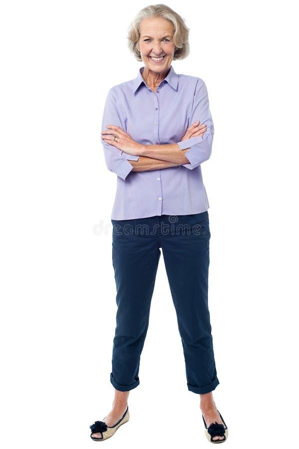 Senior woman posing over white stock images