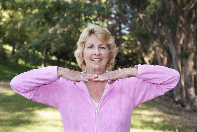 Download Senior Woman Practicing Posture In Park Stock Photo - Image: 10297114