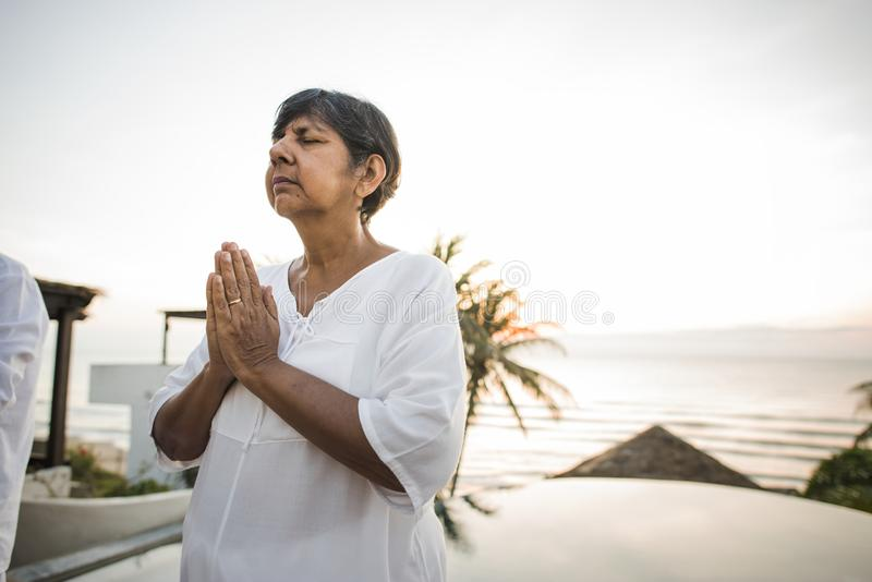 Senior woman practicing yoga in the morning royalty free stock images