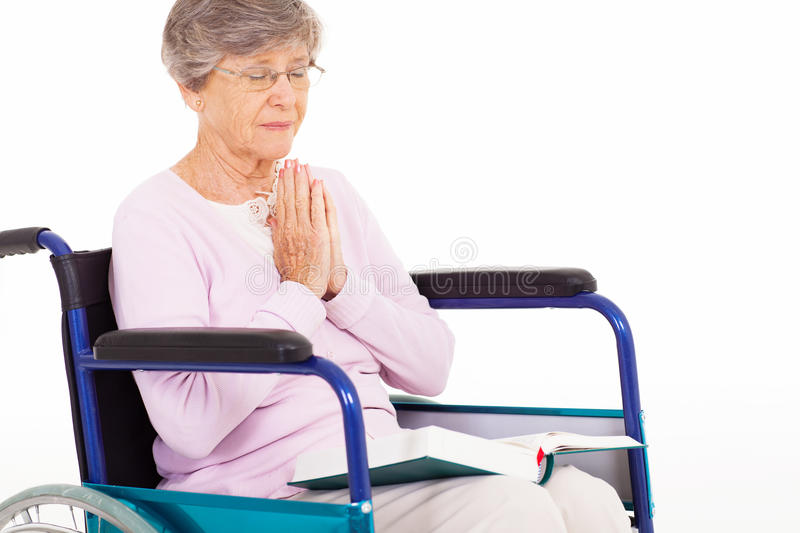 Senior woman praying stock image