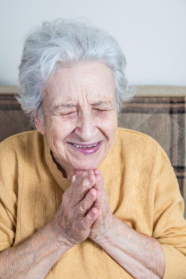 Senior woman praying / doing meditation royalty free stock image