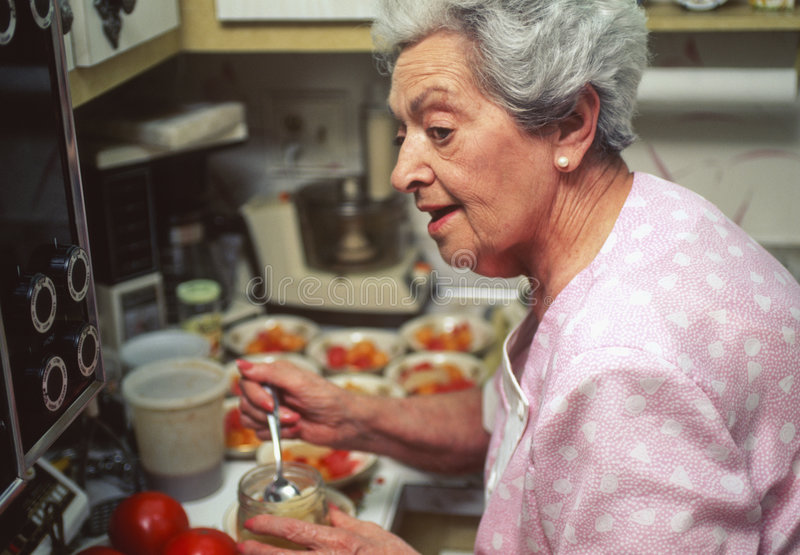 Download Senior Woman Preparing Holiday Dinner Stock Photo - Image: 6846812