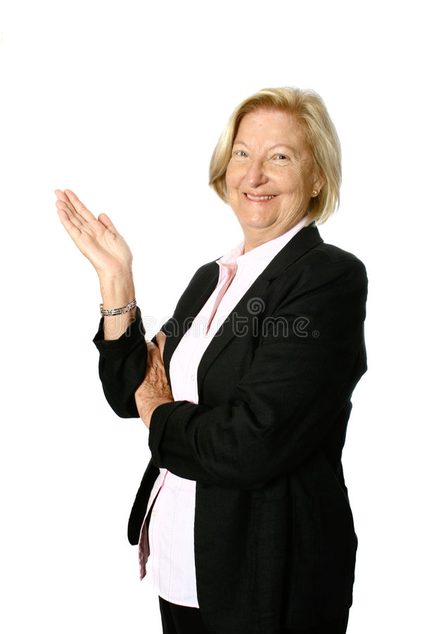 Senior woman presenting stock photos