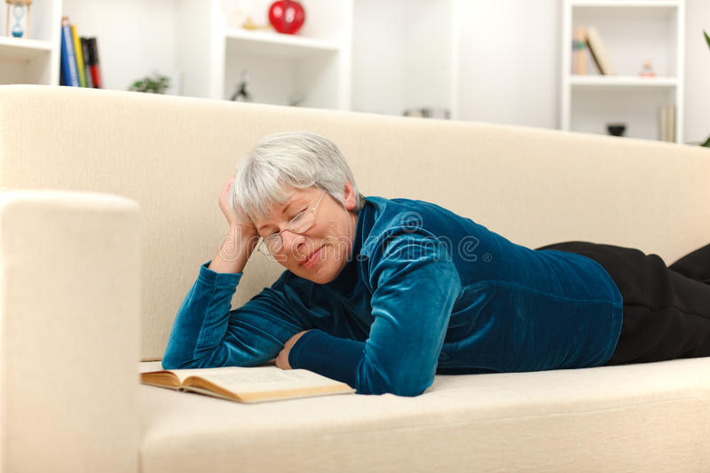 Senior woman reading royalty free stock image