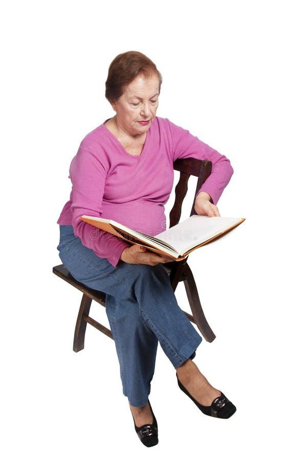 Senior woman reading book royalty free stock image