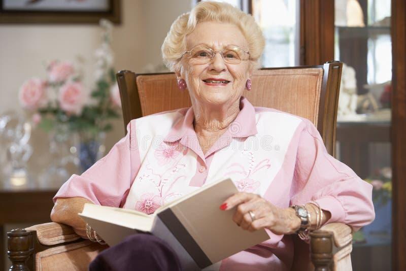 Senior Woman Reading Book Stock Image