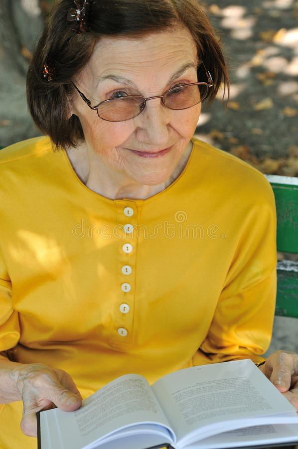 Download Senior Woman Reading Book Autdoors Stock Photo - Image: 15061274