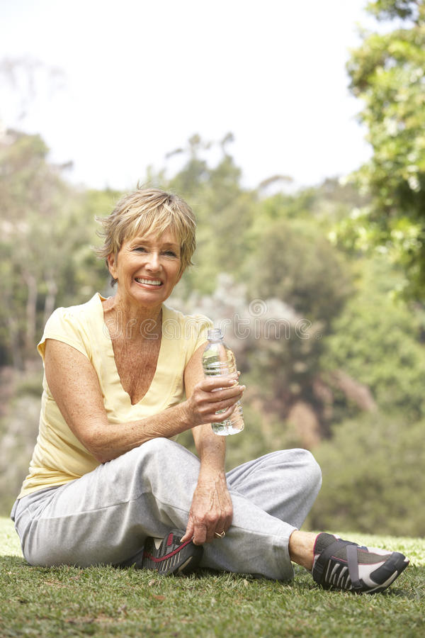 Senior Woman Relaxing After Exercise royalty free stock image