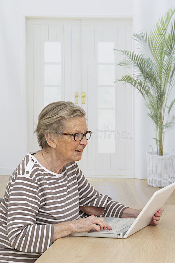 Download Senior Woman Relaxing With Her Laptop Stock Image - Image: 39272057