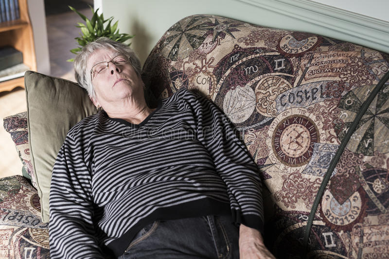 Old Woman Laying On The Sofa Stock Image Image Of Home
