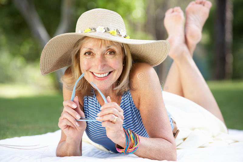 Download Senior Woman Relaxing In Summer Garden Stock Photo - Image: 26616580