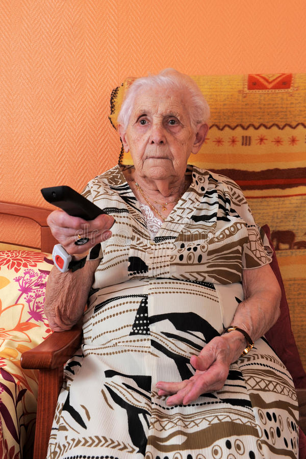 Download Senior Woman And Remote Control Stock Image - Image: 18140003