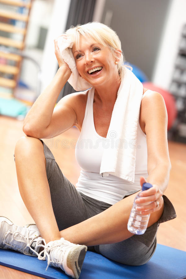Senior Woman Resting After Exercise. S In Gym royalty free stock photos