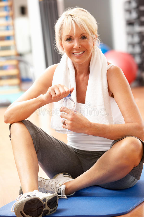 Senior Woman Resting After Exercises In Gym. Smiling at camera stock photos