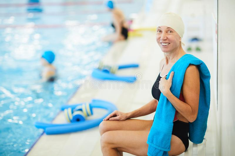 Senior Woman Resting by Pool stock photo