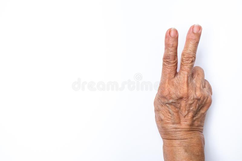Senior woman`s hands  counting 2  on white background, Numbers 1-10 in sign language concept stock photography