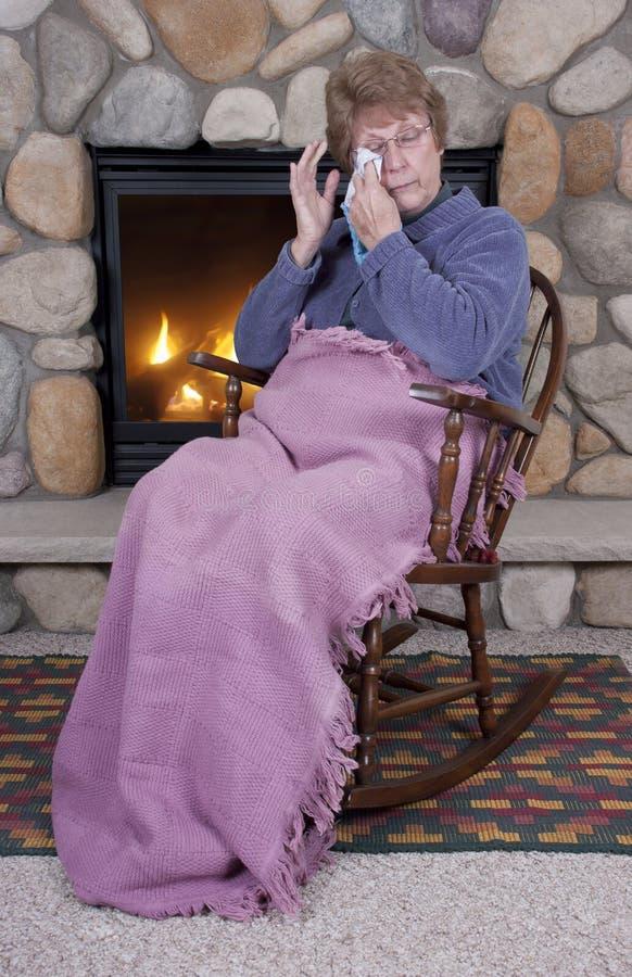 Senior Woman Sad Cry Rocking Chair Fireplace stock photos