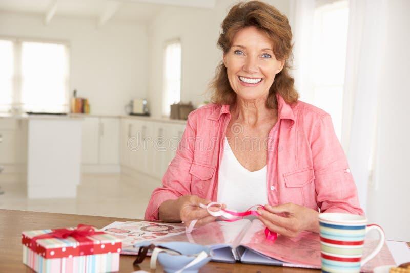 Senior woman scrapbooking royalty free stock photos