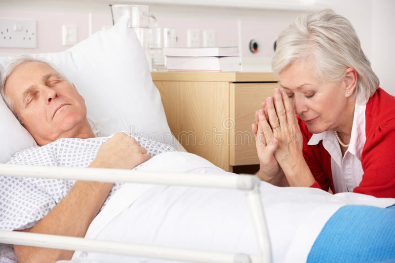 Senior woman with seriously ill husband stock images