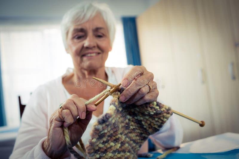 Senior woman sewing stock photo