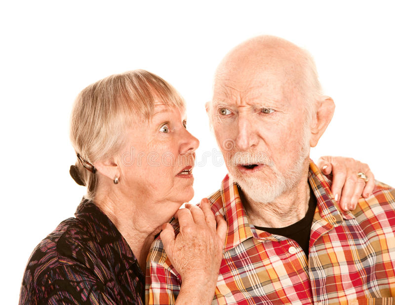 Senior woman sharing information with skeptical man stock photography