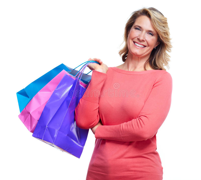 Senior woman with shopping bags. Isolated over white background stock photo