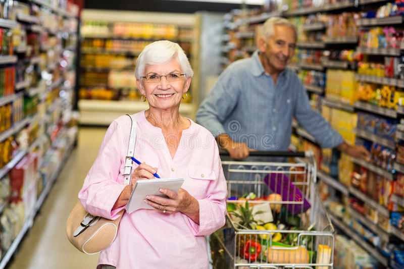 Senior woman with shopping list stock image