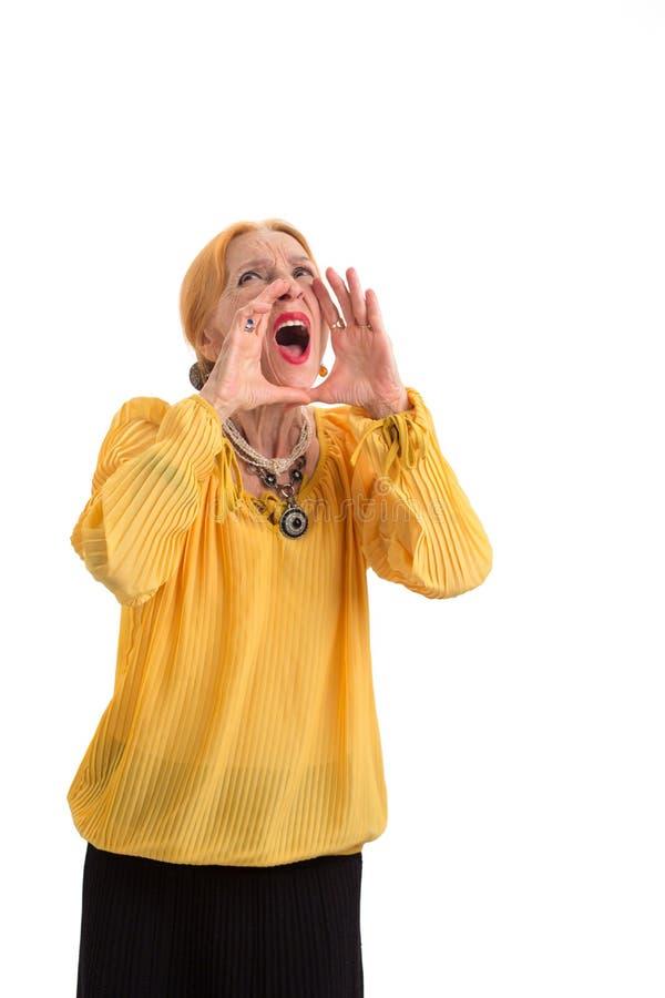 Senior woman shouting. royalty free stock photos