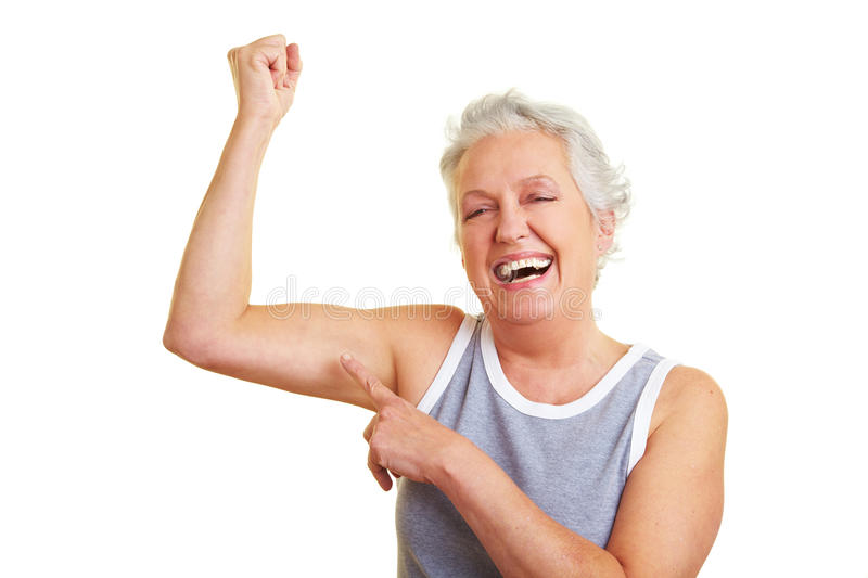 Senior woman showing her muscles royalty free stock photos