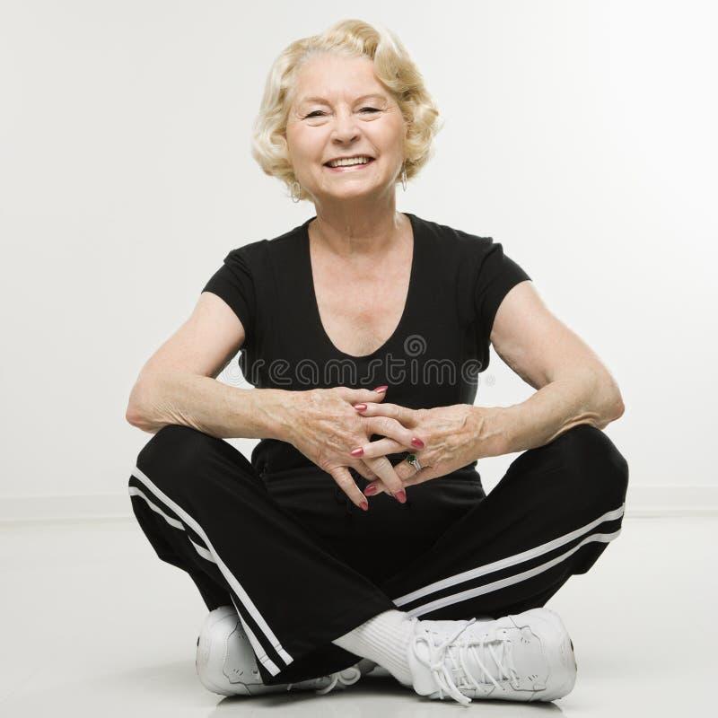 Senior woman sitting. royalty free stock images