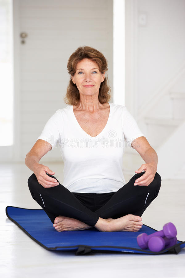 Senior Woman Sitting In Lotus Position Royalty Free Stock Photos