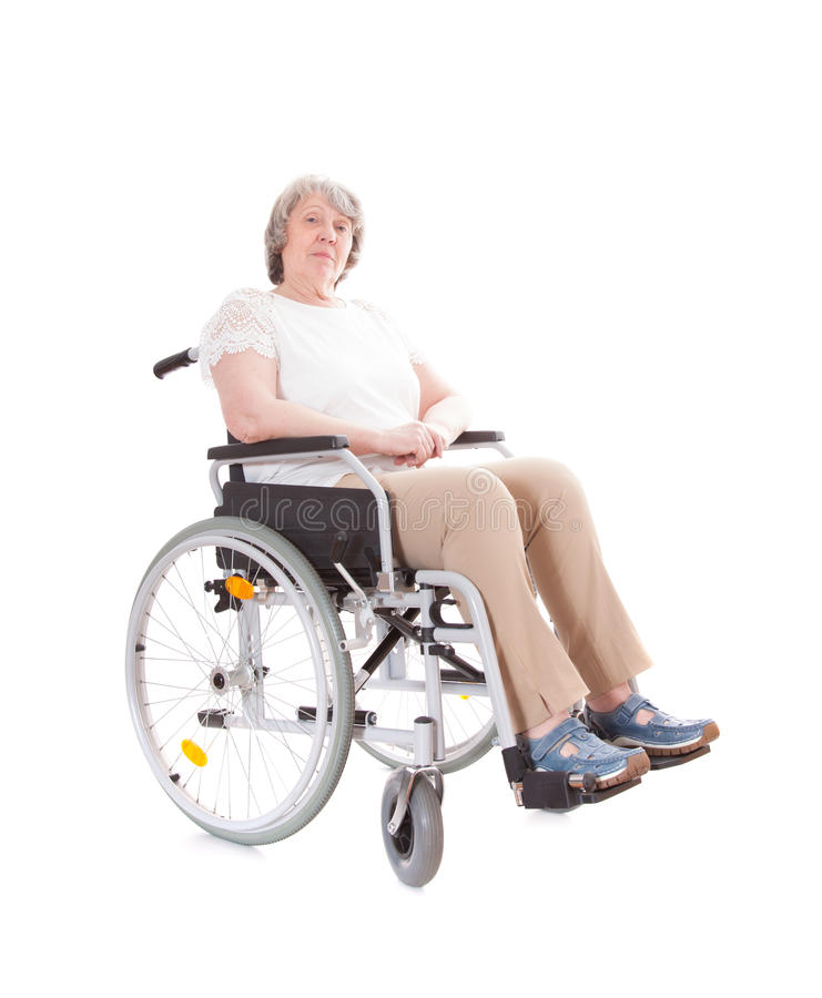 Senior woman sitting in wheel chair. All on white background stock photo